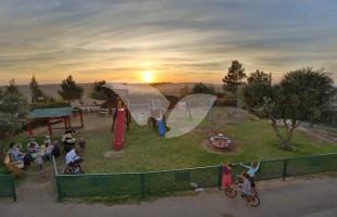Sunset and Playground in the Amona Community