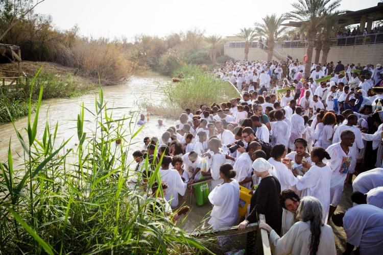 Christian Orthodox pilgrims participate in the baptism of Jesus,
