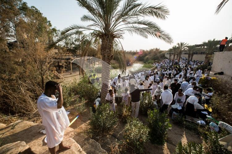 Christian Orthodox pilgrims participate in the baptism of Jesus, during the traditional Epiphany baptism ceremony at the Qasr-el Yahud baptism site in the Jordan river near the West Bank town of Jericho.