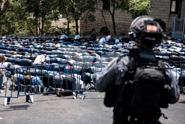Palestinians pray  outside Temple Mount
