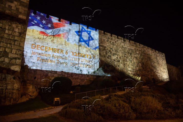 US and Israeli flag on the walls of Jerusalem's Old City