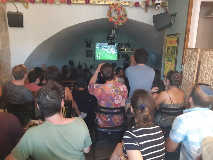 Sports fans watching the World Cup final in a Jerusalem pub