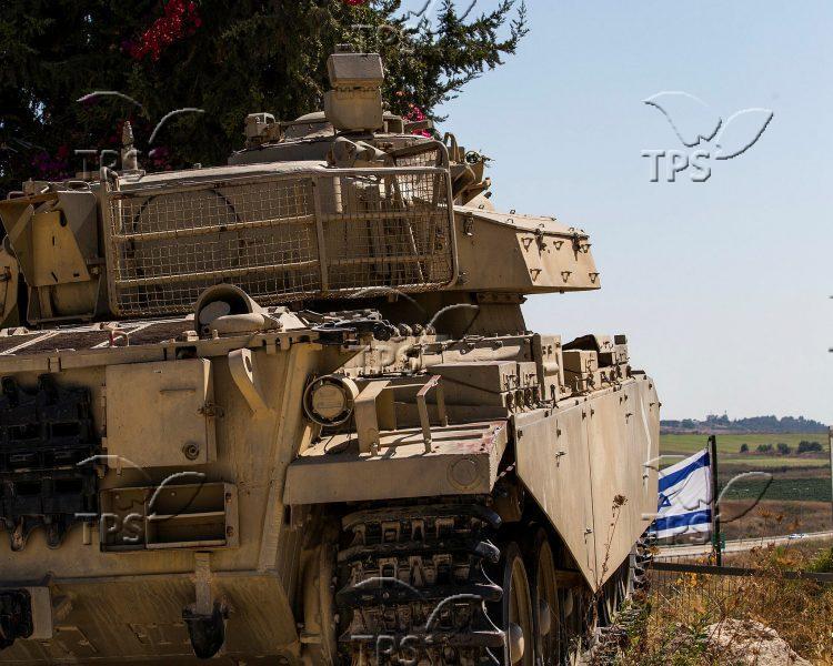 Israeli tank patrolling Syrian border