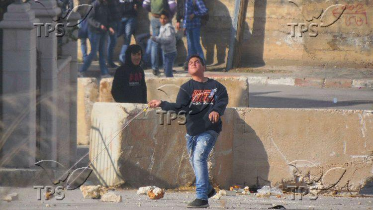 Palestinian youth attacking IDF soldiers