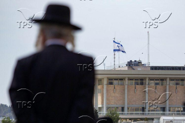 Ultra Orthodox Jew on the Background of the Knesset
