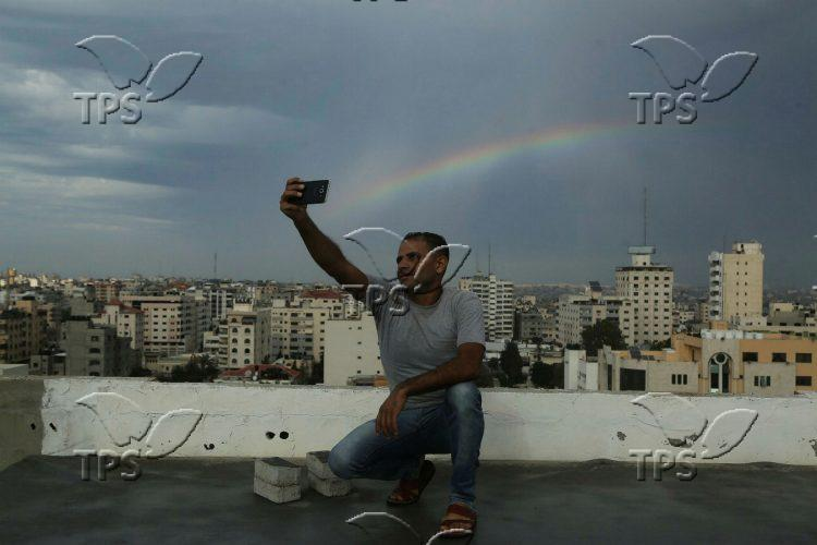 Selfie on the background of a rainbow
