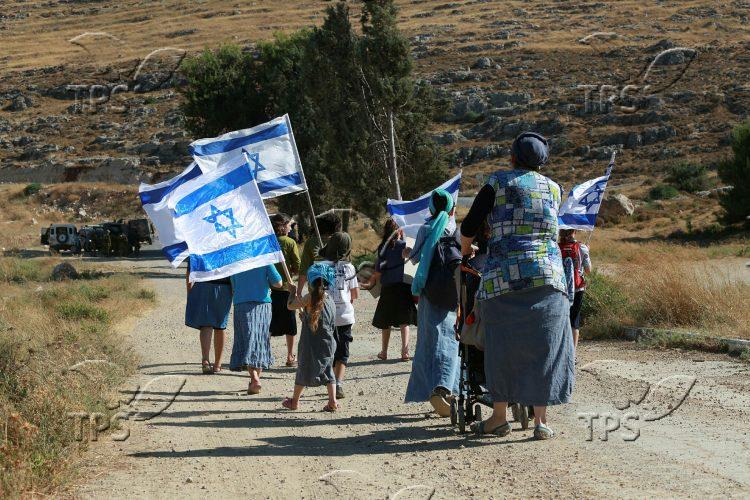 Otni'el Jewish residents marching in a protest