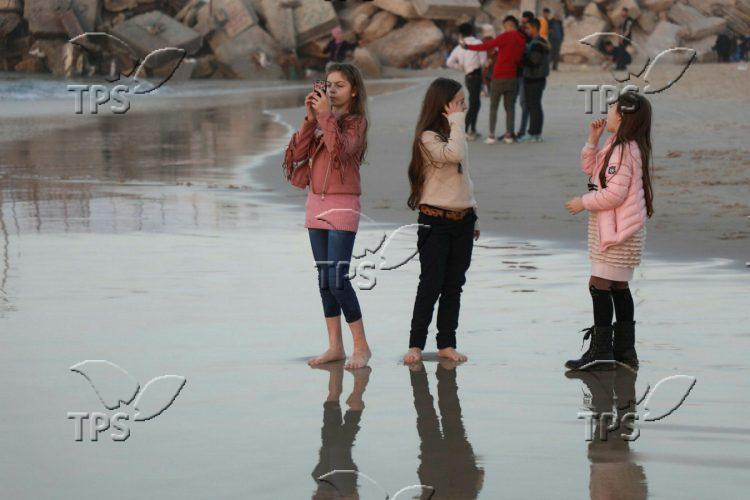 Gazans enjoying the beach of Gaza Strip