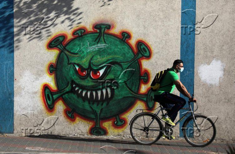 Graffiti depicting the COVID-19 coronavirus in Gaza city