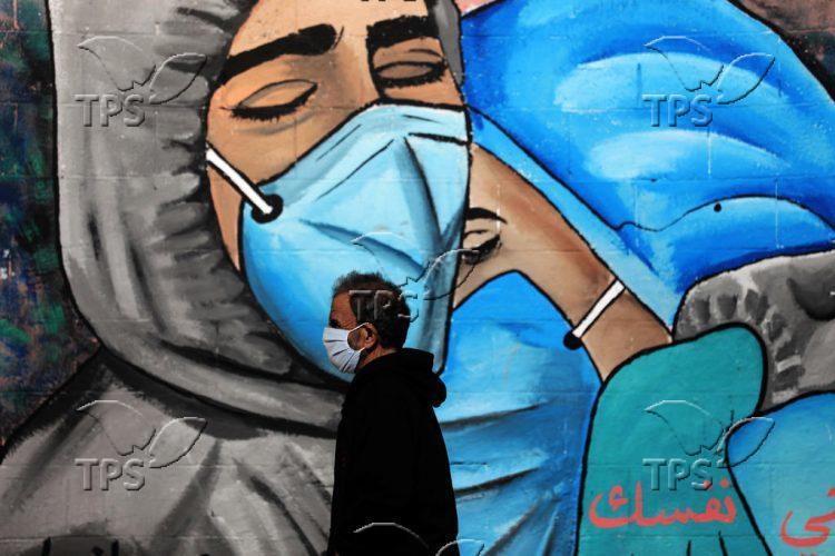 Coronavirus-themed murals in Al Nusairat refugee camp