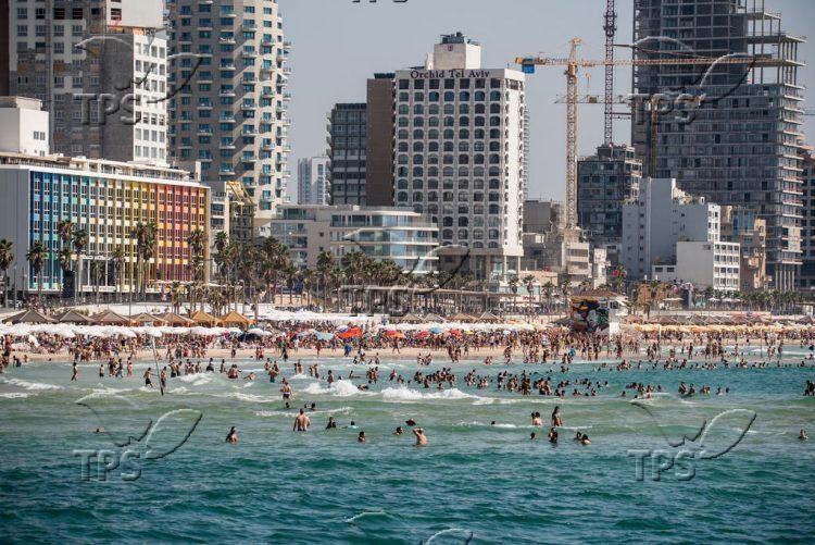 Israelis and tourists enjoy the beach in Tel Aviv Publich beach