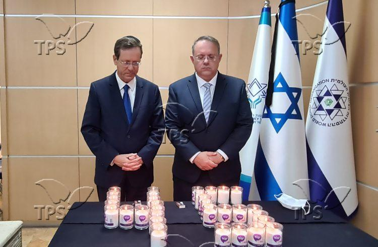 Isaac Herzog and Yaakov Hagoel lighting candles at this morning's ceremony