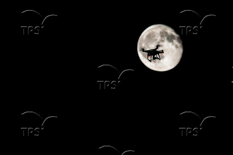 Drone on the background of the moon