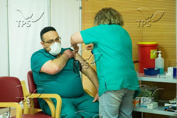 Third COVID-19 vaccine shot at Jerusalem's Hadassah Ein Kerem hospital